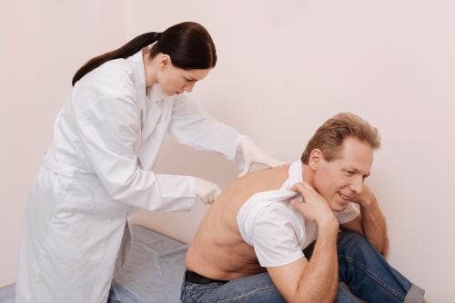 doctor checking for spinal stenosis